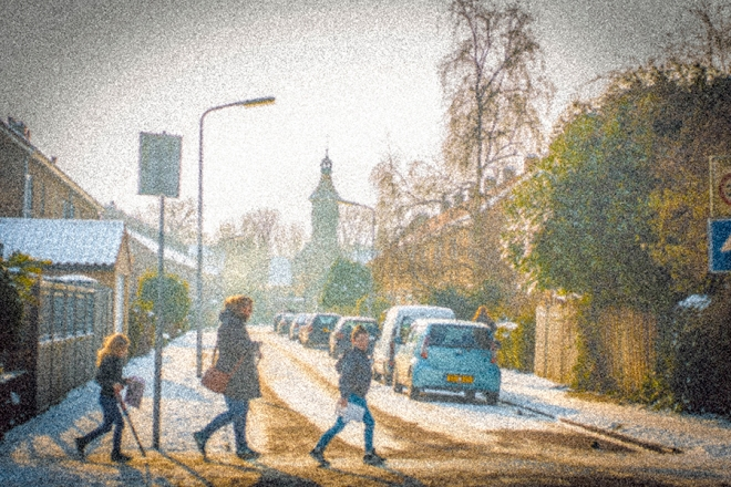 Three people crossing the roada