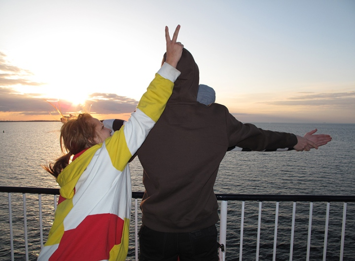 Titanic photo ruined by bunny ears - three students on a boat