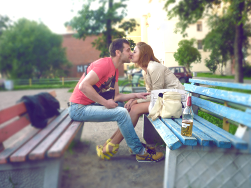 boy and girl kissing on colourful benches