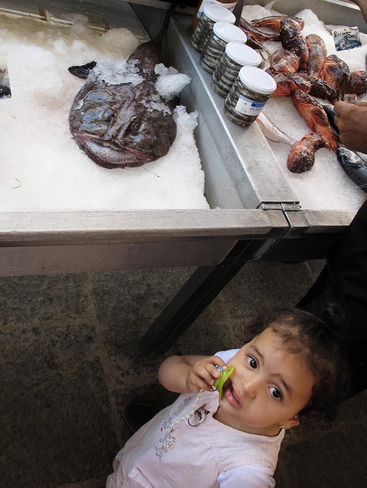 girl and fish at fish market