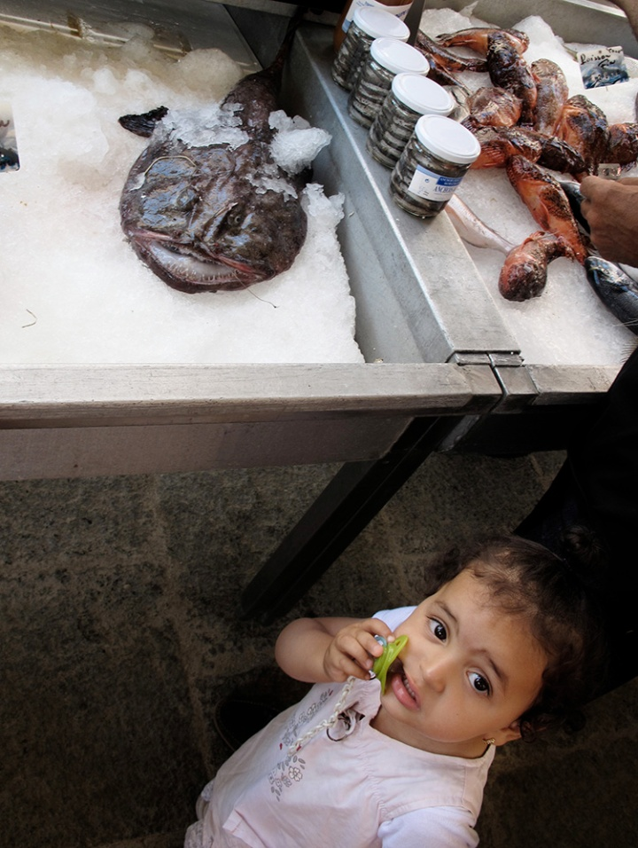 girl and fish at fish market