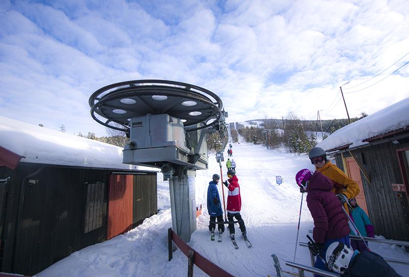 kids waiting for ski elevator