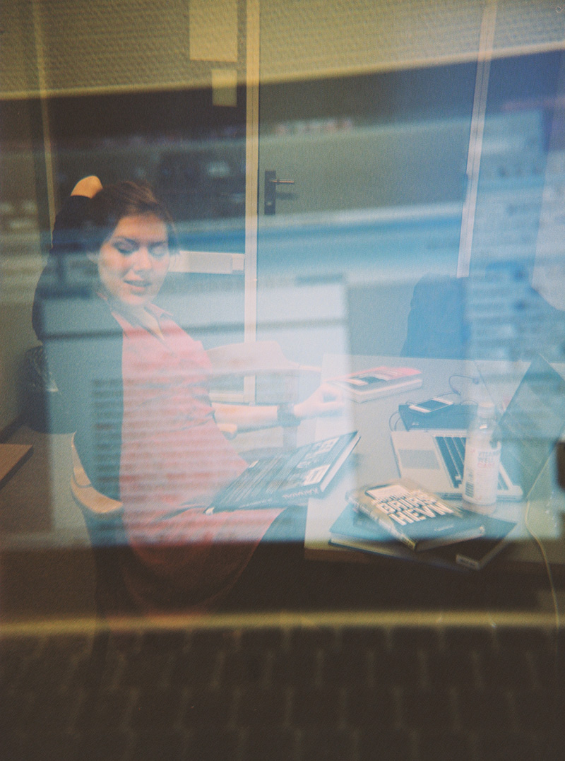 Girl sitting by her mac-book, Double exposure with Holga