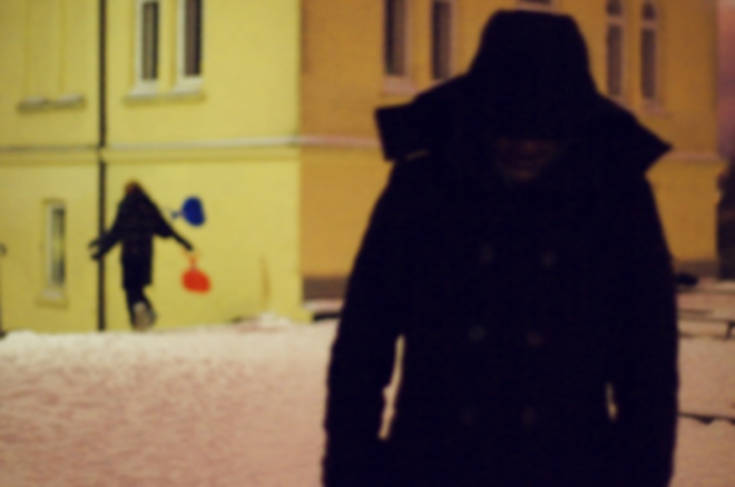 Winter scene: eery silhouette and girls going sledging