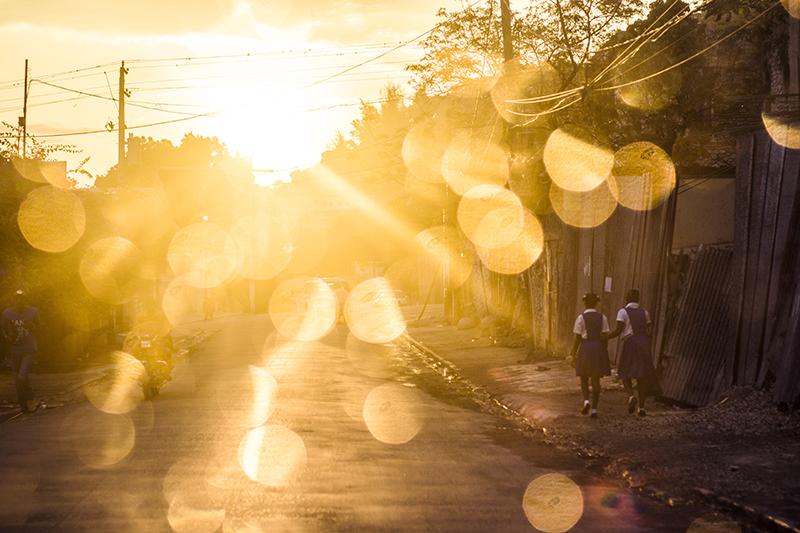 schoolgirls walking in the morning light