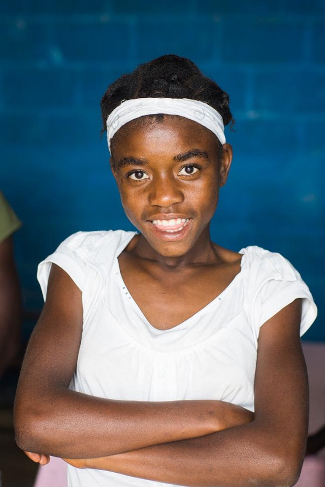 Haitian smiling school girl