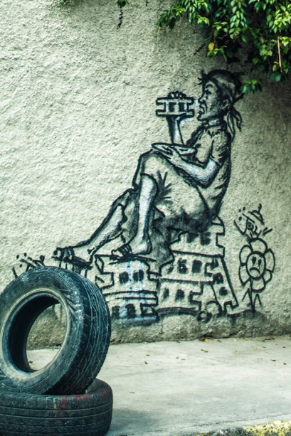 woman eating stones graffiti Petion-Ville - Haiti